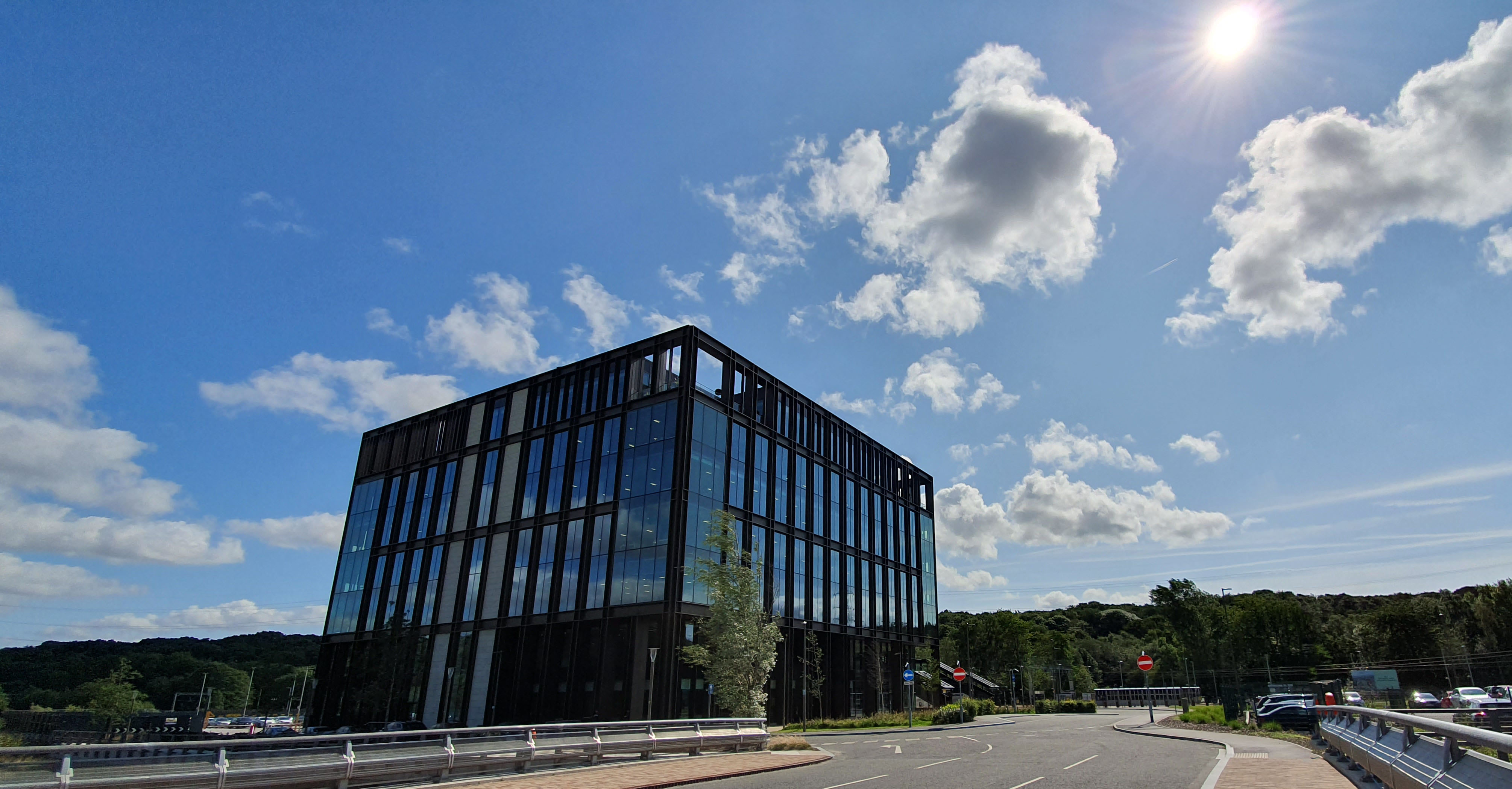 Picture of a modern office building against a blue sky